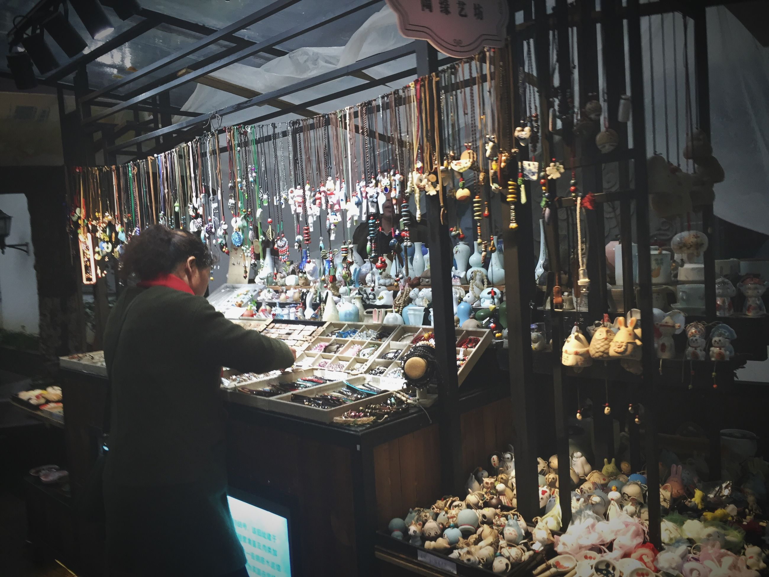 real people, one person, market, retail, large group of objects, choice, abundance, market stall, for sale, indoors, store, men, standing, food, women, day, freshness, adult, people