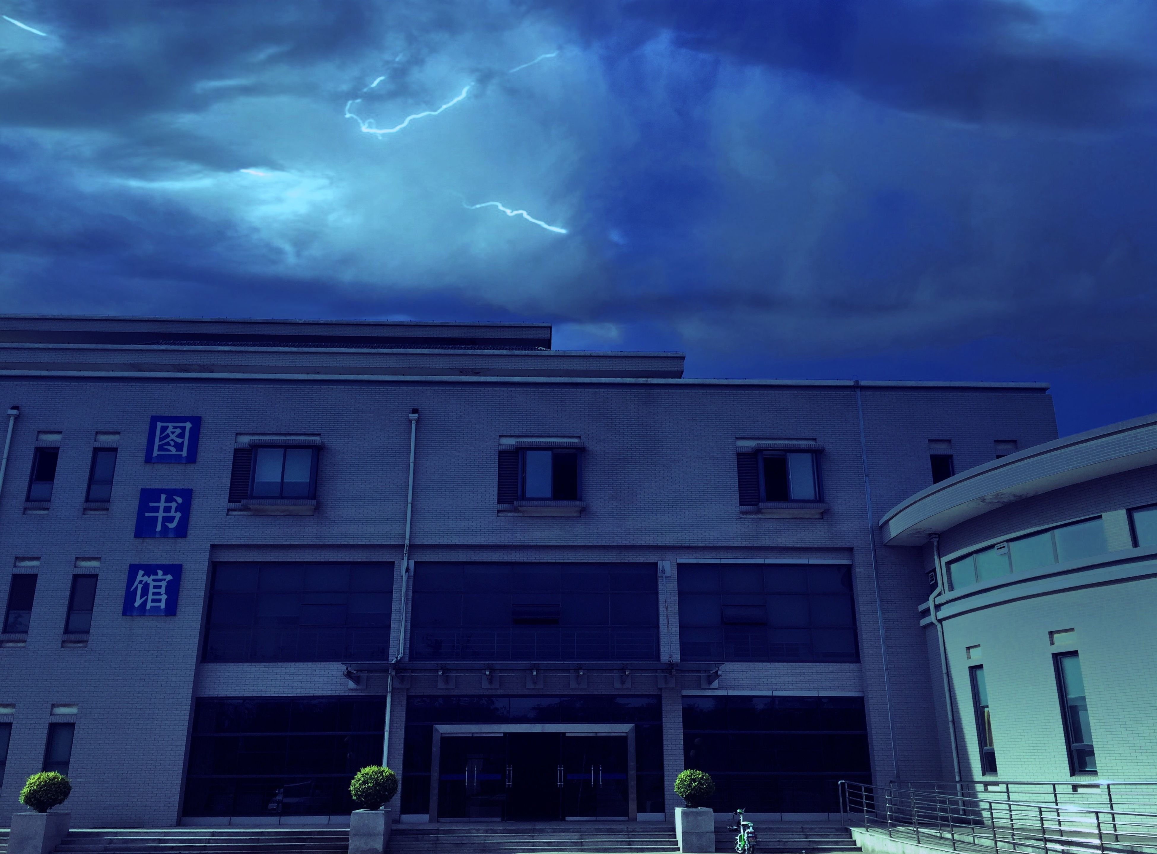 building exterior, architecture, sky, built structure, cloud - sky, cloudy, low angle view, cloud, weather, building, storm cloud, window, residential building, overcast, city, street light, dusk, residential structure, outdoors, no people