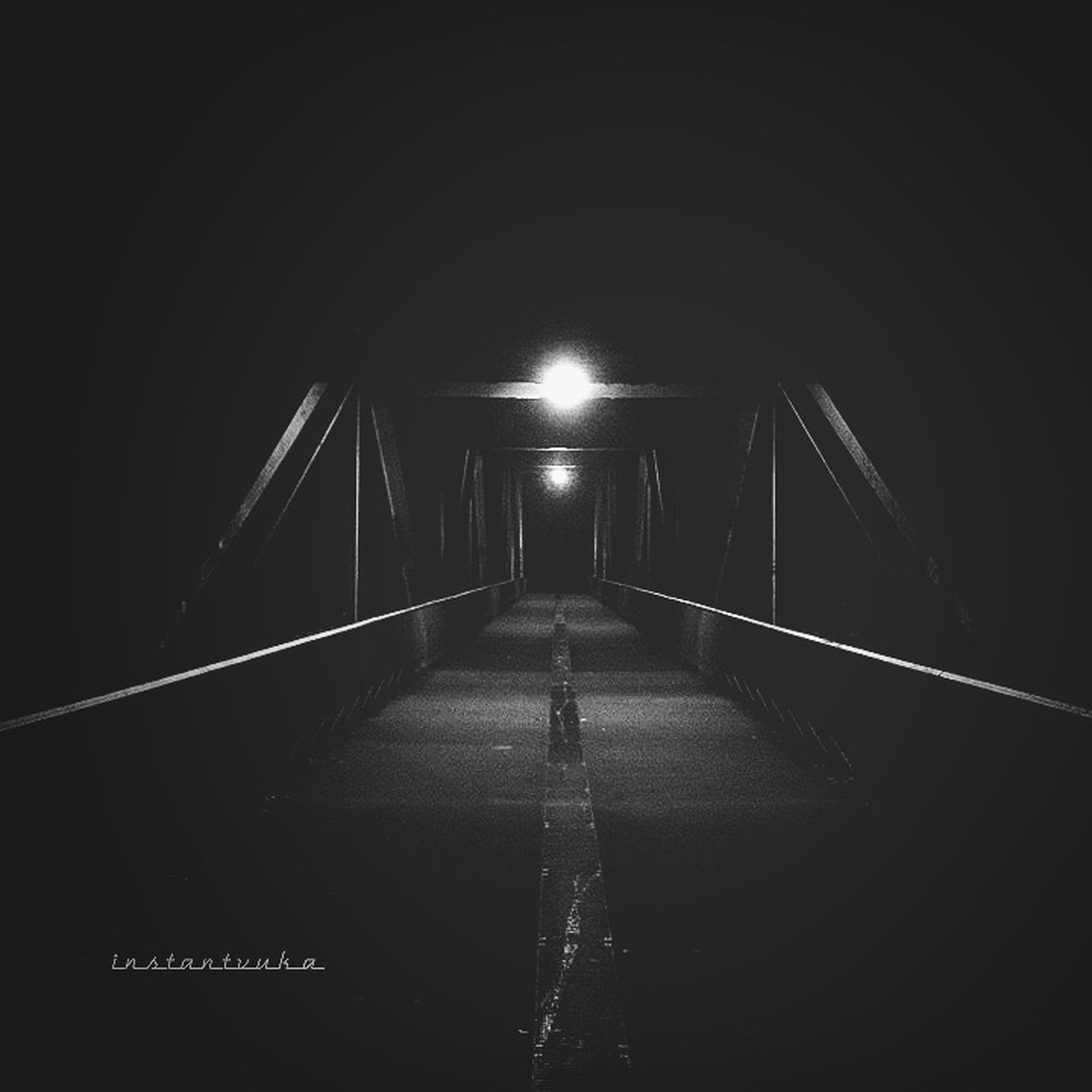 the way forward, transportation, illuminated, tunnel, indoors, night, diminishing perspective, built structure, vanishing point, connection, architecture, bridge - man made structure, dark, arch, railing, lighting equipment, road, one person, engineering, unrecognizable person
