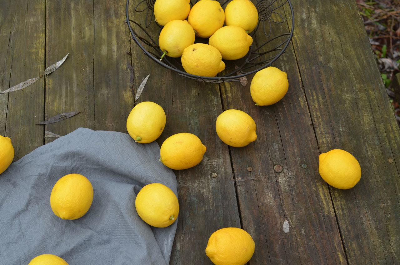 lemons on wood table Background Citrus Fruit Cooking At Home Food Background Food Preparation Fresh Fresh Lemon Fresh Produce Fruit Ingredient Lemons No People Organic Still Life Wood - Material Wood Table