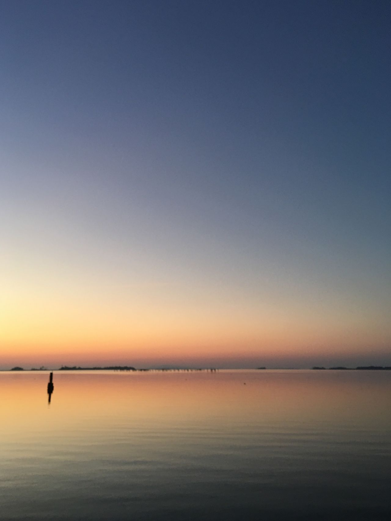 EyeEm Selects Tranquility Scenics Nature Beauty In Nature Sunset Tranquil Scene Water Idyllic Sea Sky Waterfront Outdoors Horizon Over Water No People Beach Clear Sky Day
