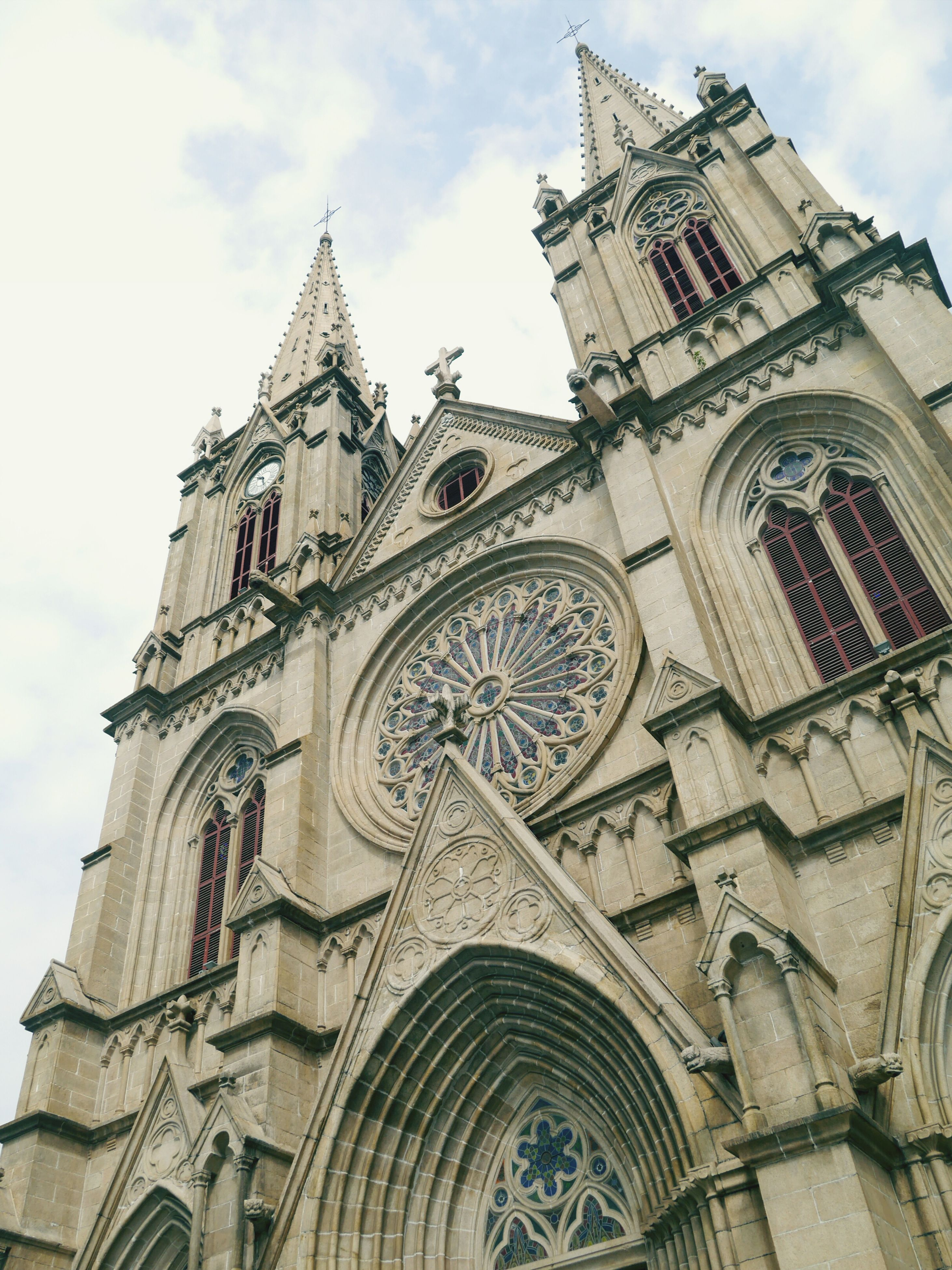 architecture, low angle view, building exterior, built structure, place of worship, religion, church, spirituality, cathedral, sky, famous place, travel destinations, history, travel, tourism, tower, capital cities, international landmark