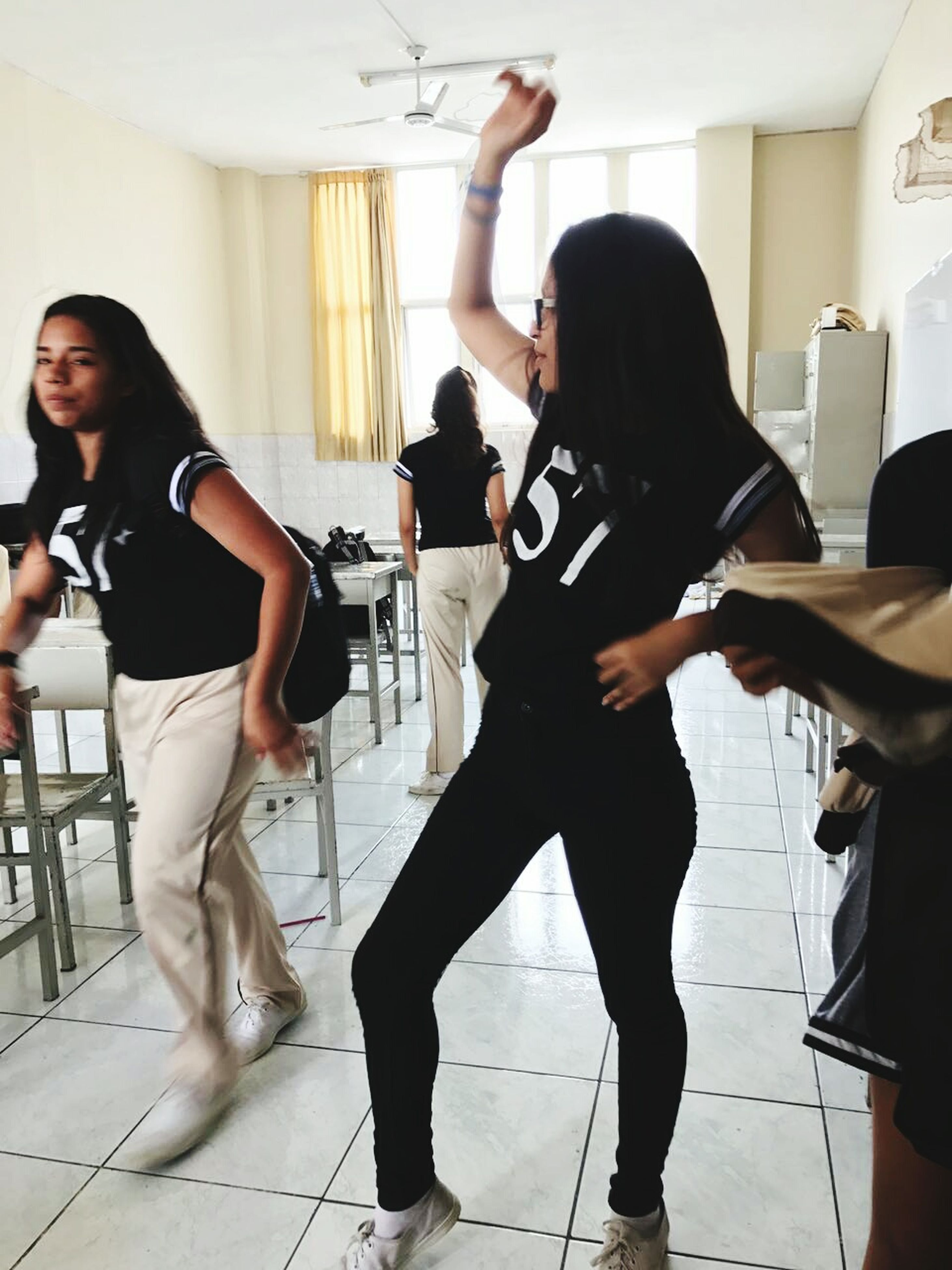 practicing, music, full length, indoors, skill, standing, expertise, performance, only women, leisure activity, lifestyles, playing, people, adults only, musician, musical instrument, violin, bass guitar, performing arts event, adult, day