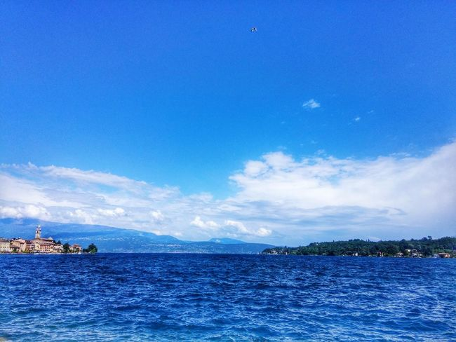 Salò, Italy. Water Blue Water Blue Sea Scenics Waterfront Tranquil Scene Tranquility Sky Beauty In Nature Idyllic Cloud Seascape Nature Calm Day Coastline Water SurfaceNature Gardalake Italy Italy🇮🇹 Outdoors Ocean Blue Color Flying High