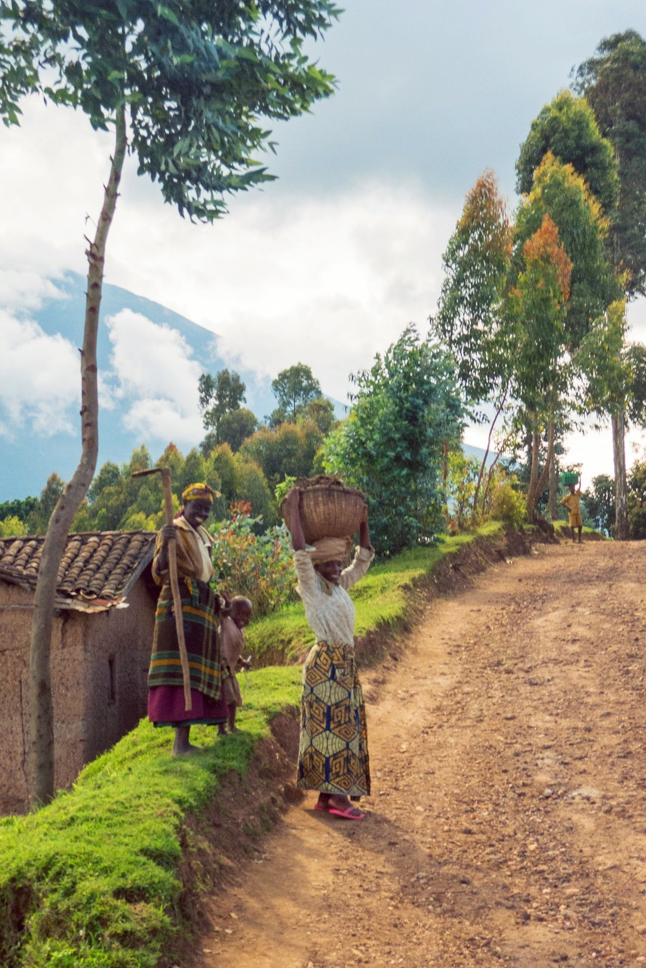 Women near the twin lakes in Ruhengeri (Musanze) Rwanda head home with full baskets in the late afternoon. RePicture Travel Streetphotography Streetphoto_color Travel Photography Africa Peoplephotography Happy People Rural Scenes Cheese!
