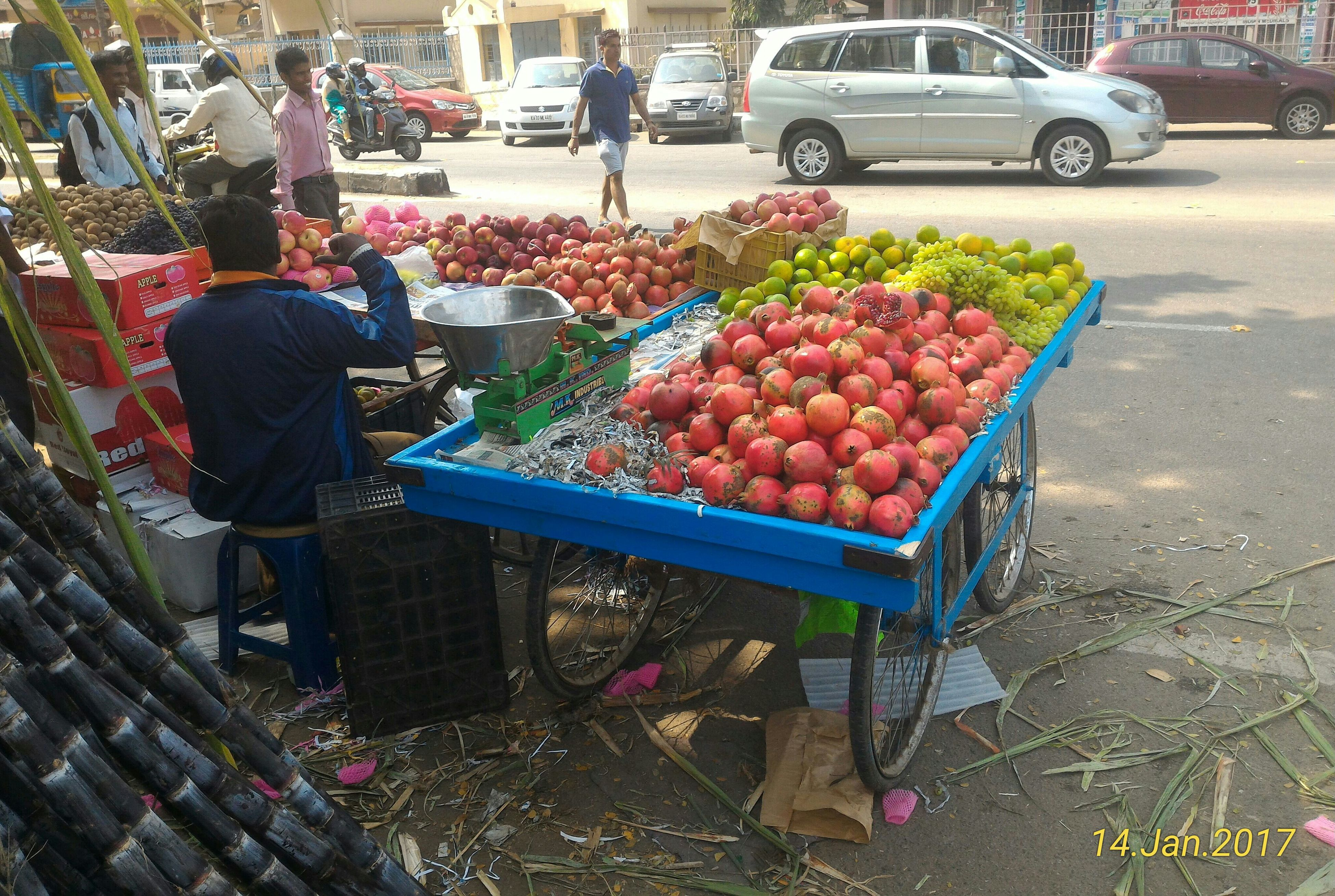 food and drink, for sale, market stall, food, fruit, retail, market, variation, occupation, freshness, choice, men, real people, land vehicle, day, healthy eating, outdoors, one person, adult, people
