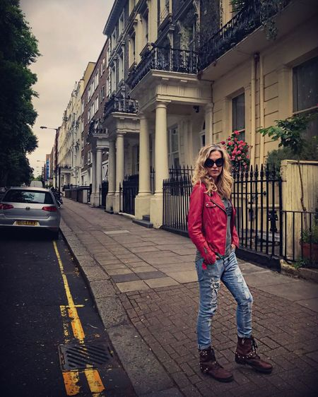London Kensington Building Exterior City Street One Person Architecture Outdoors Built Structure City Life Day Casual Clothing Leather Jacket Leisure Activity Red Jacket Women Lifestyles Solitude Attitude