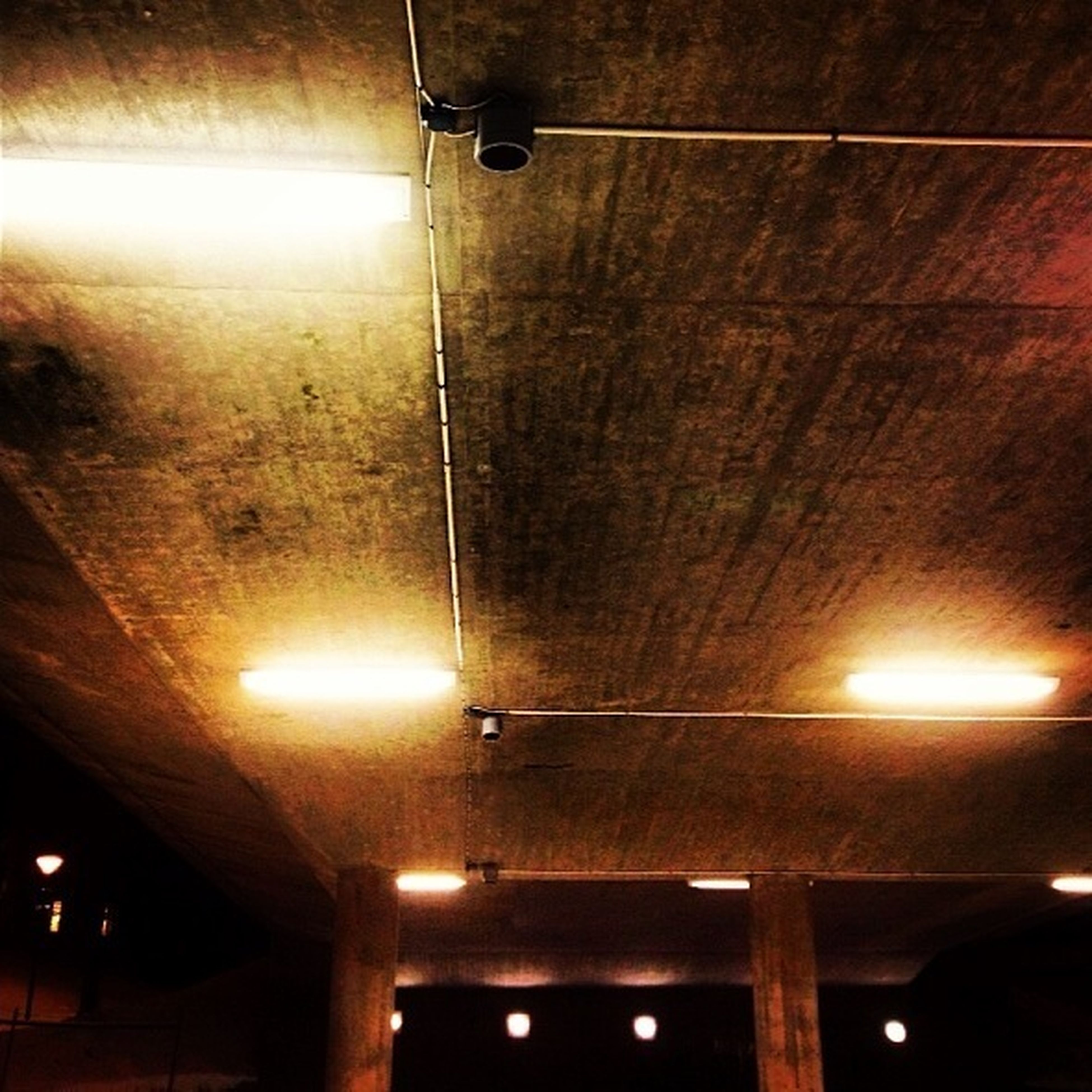illuminated, indoors, ceiling, lighting equipment, low angle view, electricity, electric light, light - natural phenomenon, interior, architecture, built structure, night, lamp, hanging, glowing, electric lamp, lit, no people, technology, in a row