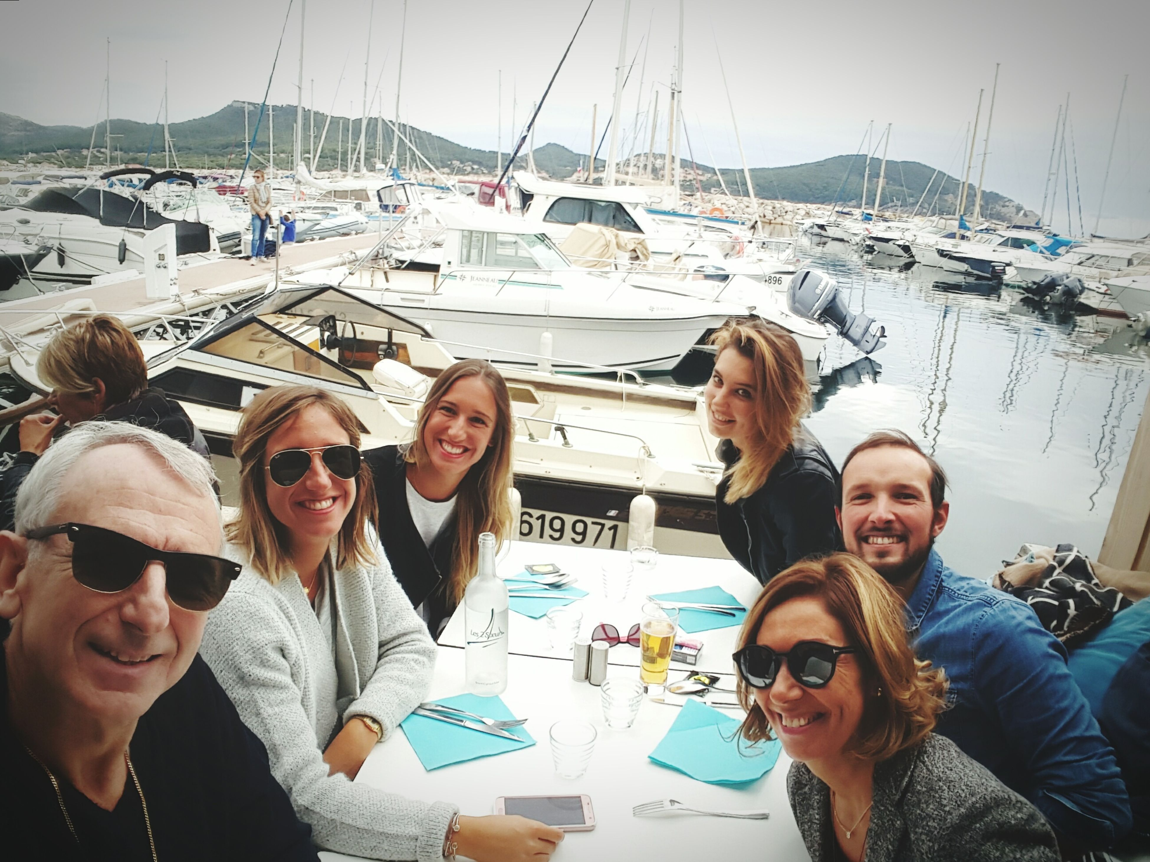 togetherness, person, casual clothing, leisure activity, bonding, nautical vessel, lifestyles, happiness, clear sky, love, young adult, transportation, young women, smiling, portrait, toothy smile, friendship, mode of transport, sunglasses, front view, water, looking at camera, day, sky, vacations, sea, looking
