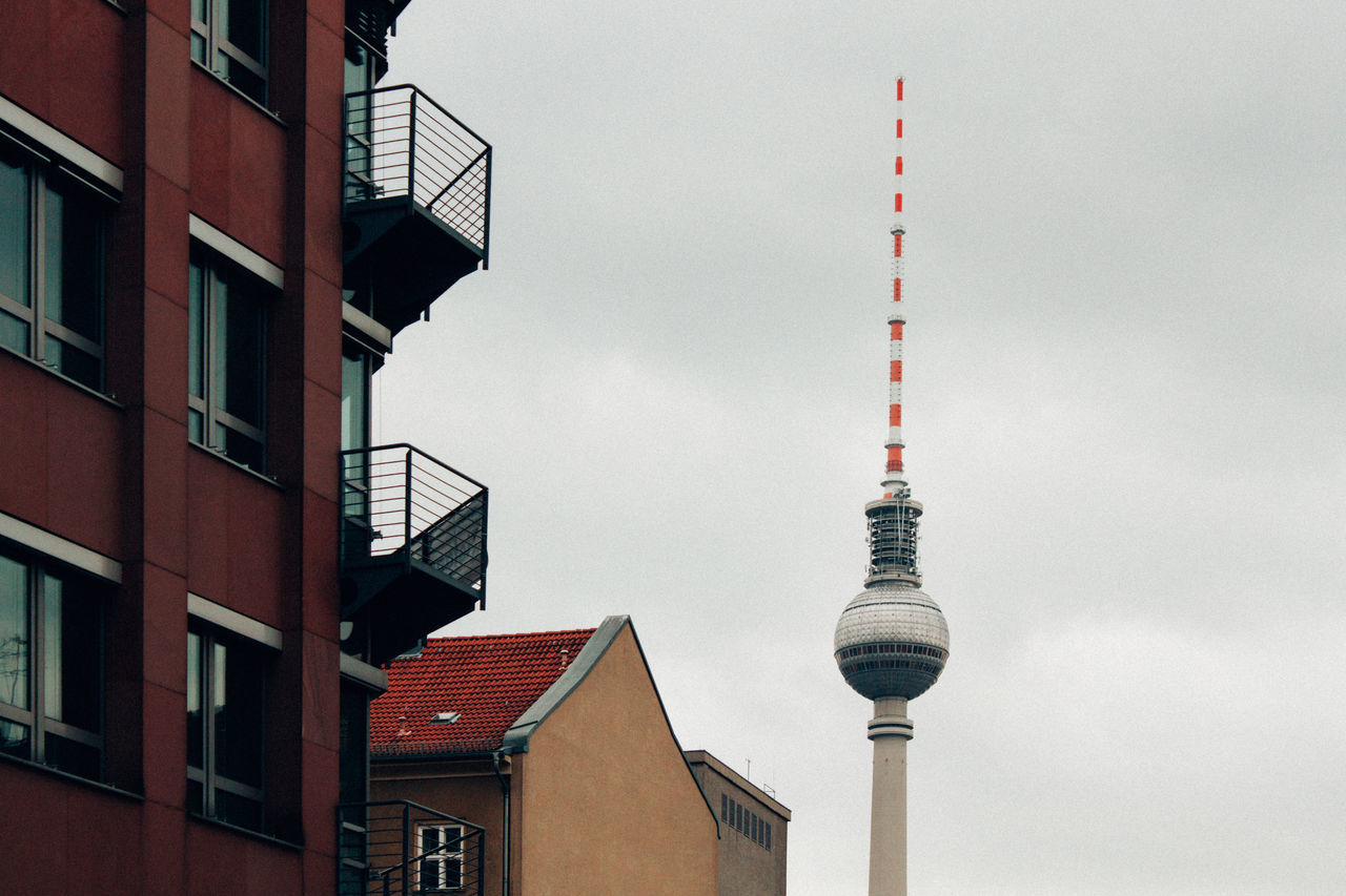City contrasts. Architecture Berlin Berlin Photography Berliner Ansichten Building Exterior Built Structure City Cloud Communication Day Fernsehturm Low Angle View No People Outdoors Sky Streetphotography Tall - High Technology Television Tower Tower Travel Destinations TV Tower Urban