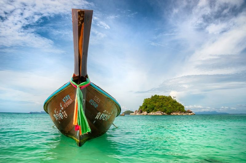 Thai longtail boat on Gorgeous Sunrise beach of beautiful Koh Lipe, Thailand Beautifulthailandbeach Kohlipe Kohlipebeach Kohlipethailand Longtailboat Sunnythailand Sunrisebeachkohlipe Thailandbeach Thailongtailboat Turquoisebeachthailand