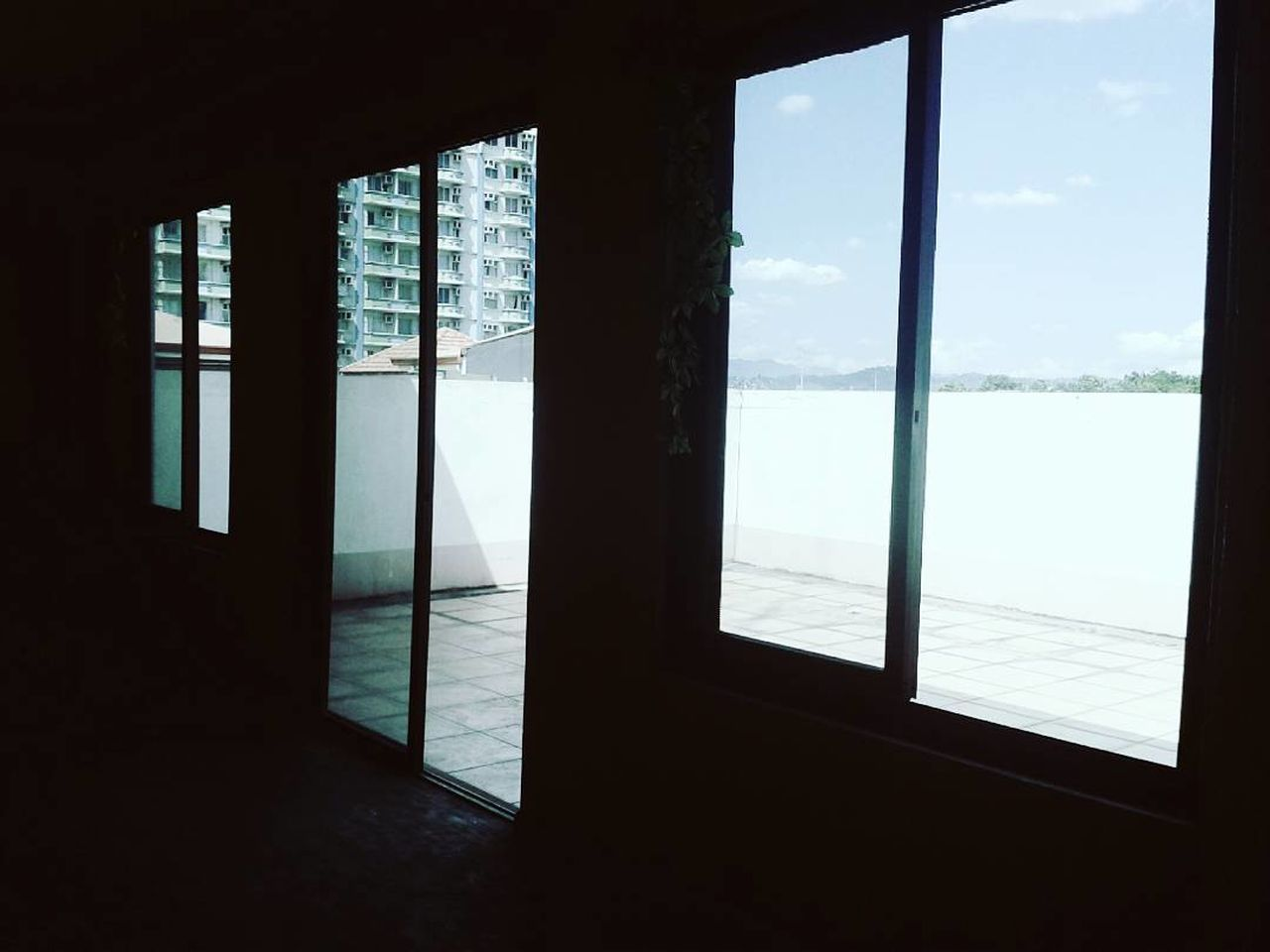 Window Indoors  Sea Water Architecture Travel Destinations Day Home Interior Domestic Life Vacations Lifestyles Modern Built Structure Sky Sliding Door Nature No People Beach Cityscape MyPics Indoors  Close-up