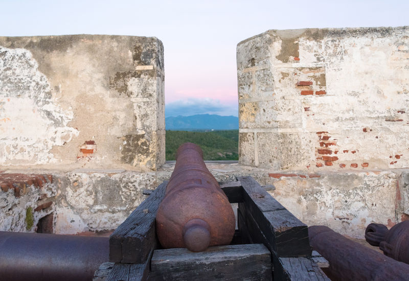 Old cannon guns and wall in 'El Morro' de Santiago de Cuba or Saint Peter of the Rock Spanish colonial military fortress. The place is a Unesco World Heritage Site After Beautiful Building Colonial Cuba Day Fortress Heritage Historic History Landmark Military Old Santiago De Cuba Spanish Sunset Tourism Tourist Attraction  Tourist Attractions Tourist Destination Traveling Unesco World Heritage UNESCO World Heritage Site Unescoworldheritage Vintage