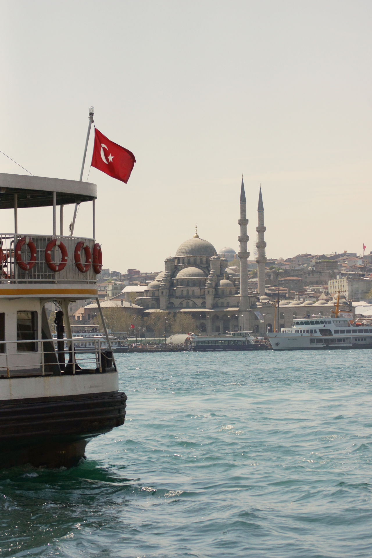 View across the Golden Horn Architecture Bosphorus Building Exterior City Cityscape Day Dome Ferry Flag Golden Horn Istanbul Minaret Mosque Nautical Vessel No People Orient Oriental Outdoors Ship Sky Travel Travel Destinations Turkey Water Yeni Camii