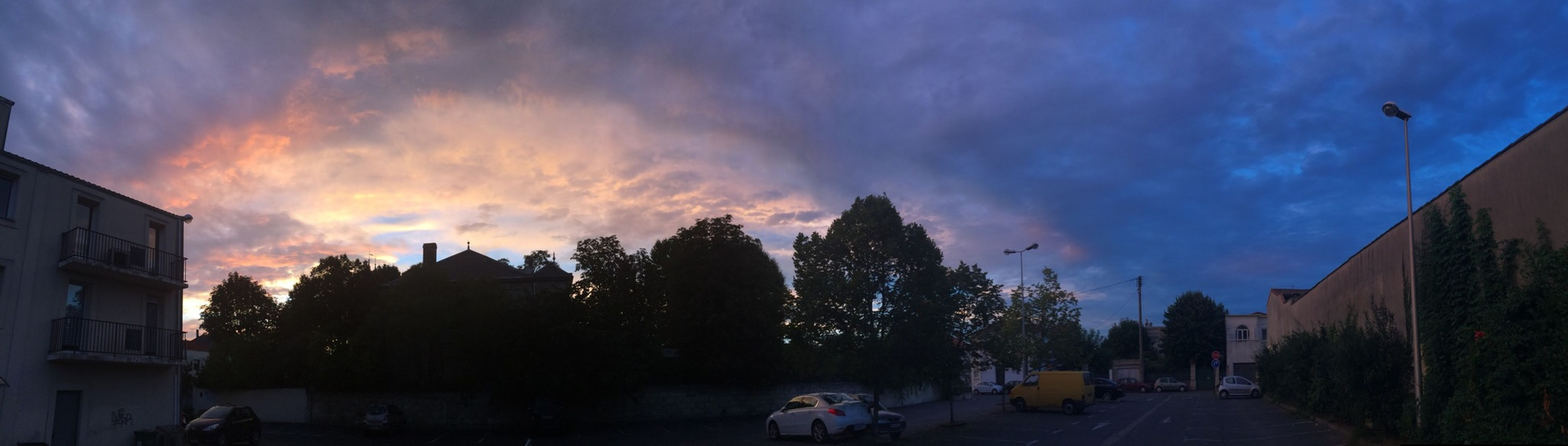 sky, building exterior, cloud - sky, built structure, architecture, silhouette, sunset, street, dusk, tree, cloud, car, cloudy, road, house, city, residential structure, transportation, outdoors, residential building