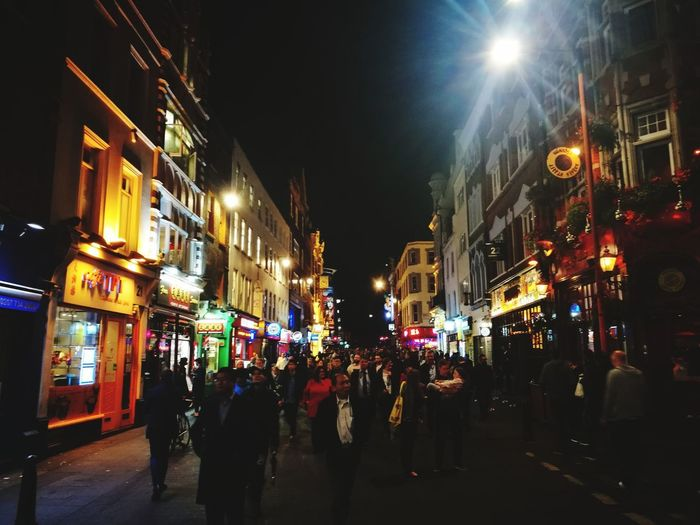 China town in London. Night City City Street Illuminated Crowd Large Group Of People City Life Architecture Police Force Street People Nightlife Conflict Building Exterior Cityscape Riot Protestor Travel Destinations Adults Only Adult London Chinatown Chinatown London Firework Display Architecture