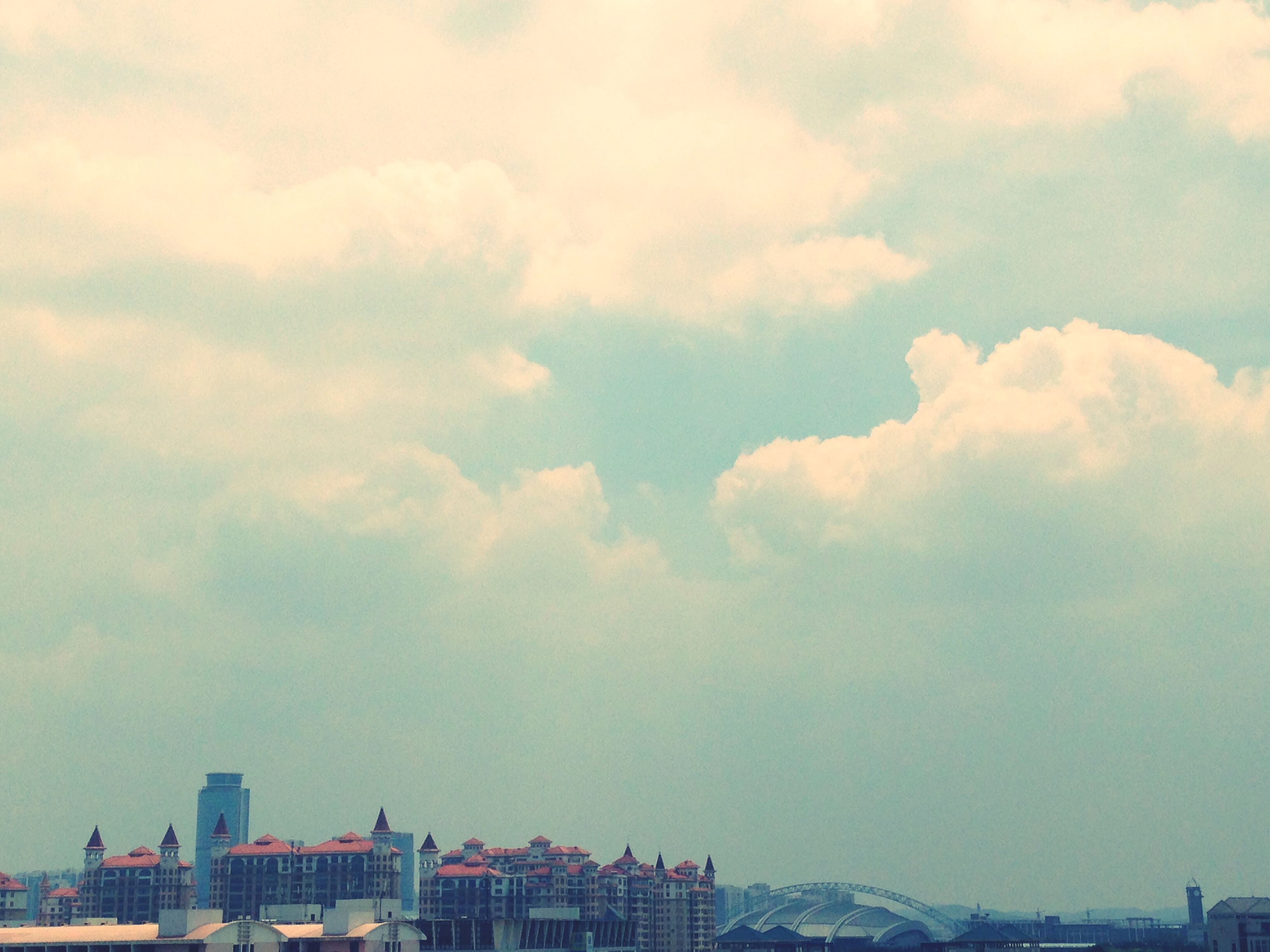 building exterior, architecture, built structure, sky, cloud - sky, cloudy, city, cloud, residential building, residential structure, cityscape, low angle view, building, weather, outdoors, house, day, nature, residential district, no people