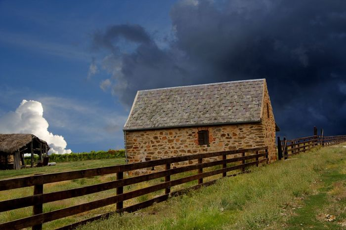 Storm brewing across a vineyard in the Barossa Valley, South Australia Architecture Australian Landscape Barn Barossa Valley Building Exterior Built Structure Cloud - Sky Day Farm Building Fence Grass Nature No People Outdoors Rural Scene Sky Storm Clouds
