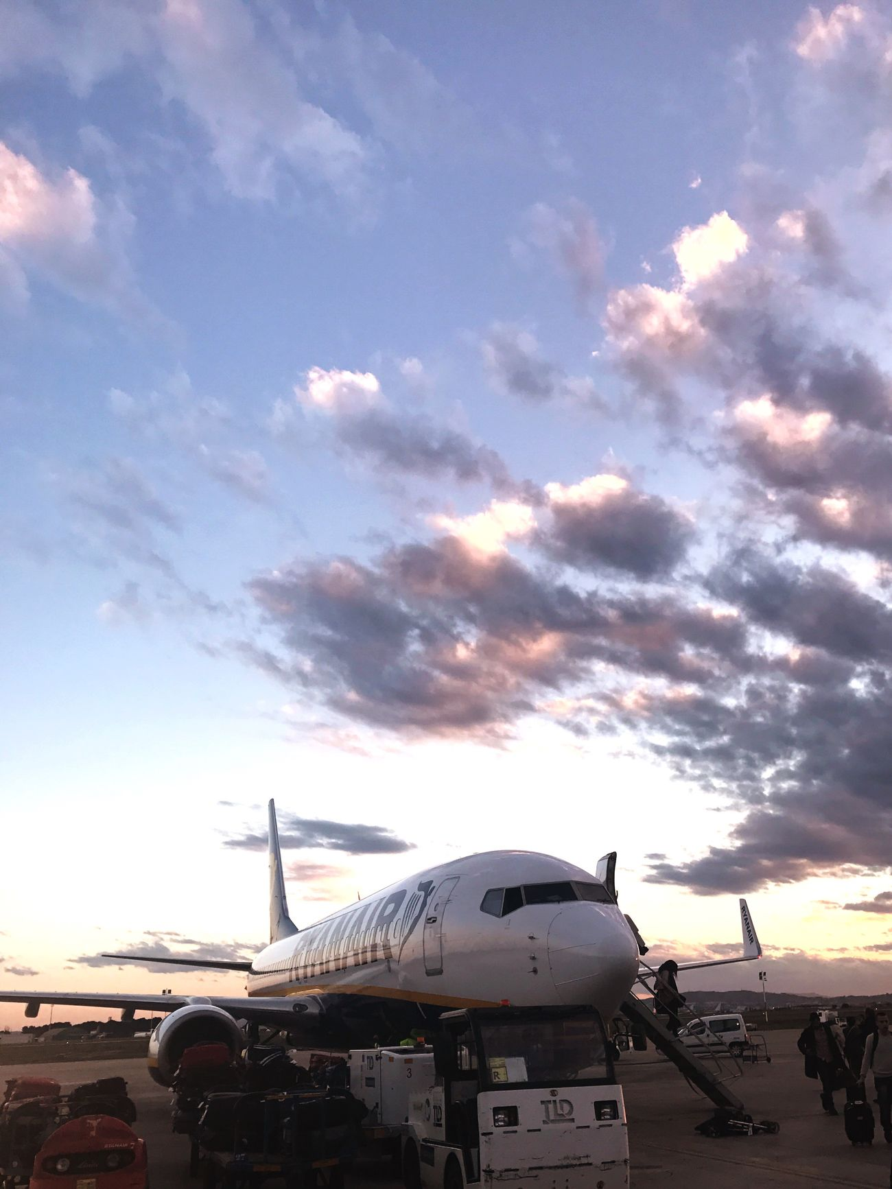 Valencia's sky is beautiful Airplane Airport Transportation Sky Airport Runway Travel Air Vehicle Outdoors Passenger Boarding Bridge Commercial Airplane Day No People