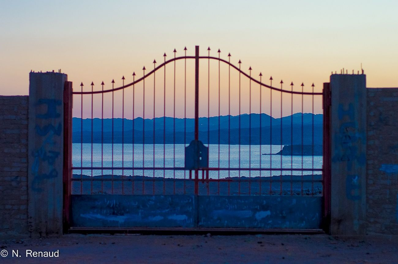 Sunset Men Outdoors Full Length Only Men Suspension Bridge Fog Sky Sea One Person Adult City One Man Only Bird Silhouette People Urban Skyline Adults Only Cityscape Cyberspace