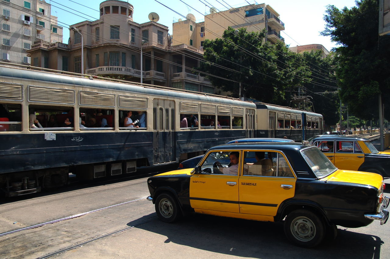 Alexandria Egypt Architecture Building Exterior City City Life City Street Day Mode Of Transport No People Outdoors Street Taxi Tram Transportation Travel Destinations Yellow Taxi