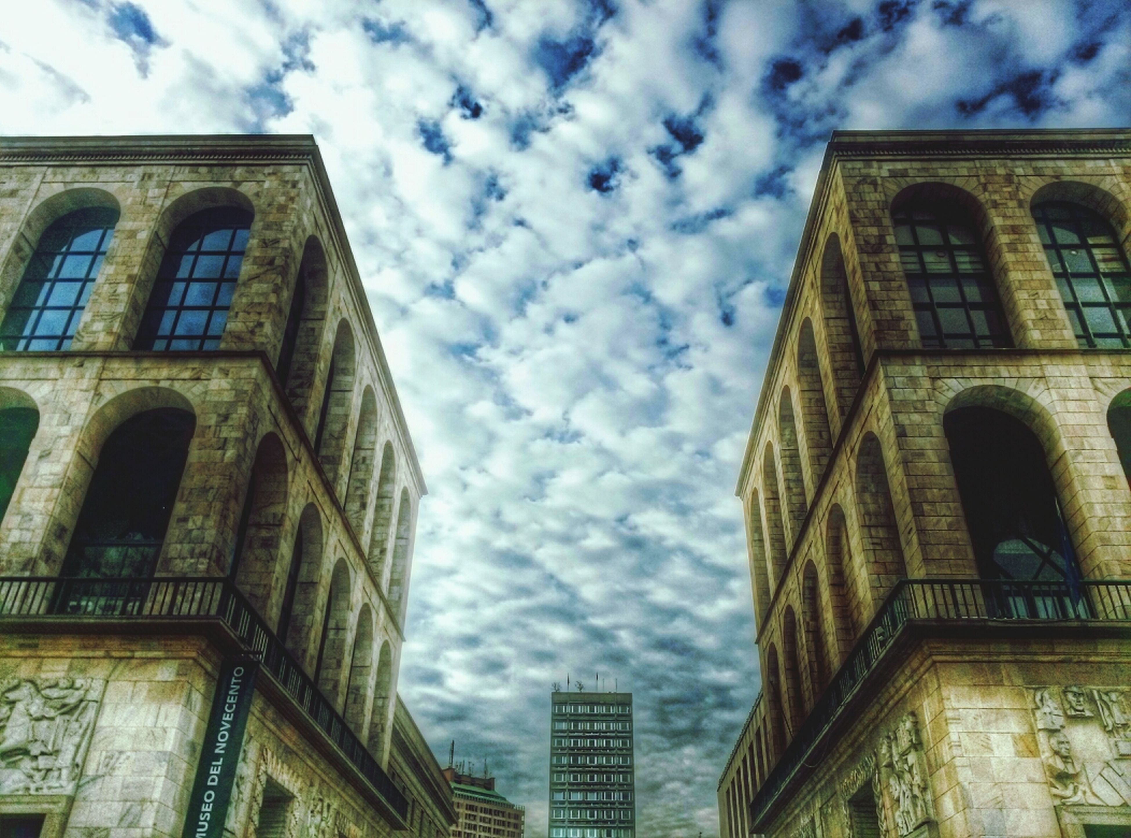 architecture, building exterior, built structure, low angle view, sky, cloud - sky, cloud, window, building, city, cloudy, day, arch, outdoors, residential building, no people, residential structure, tower, tall - high, glass - material