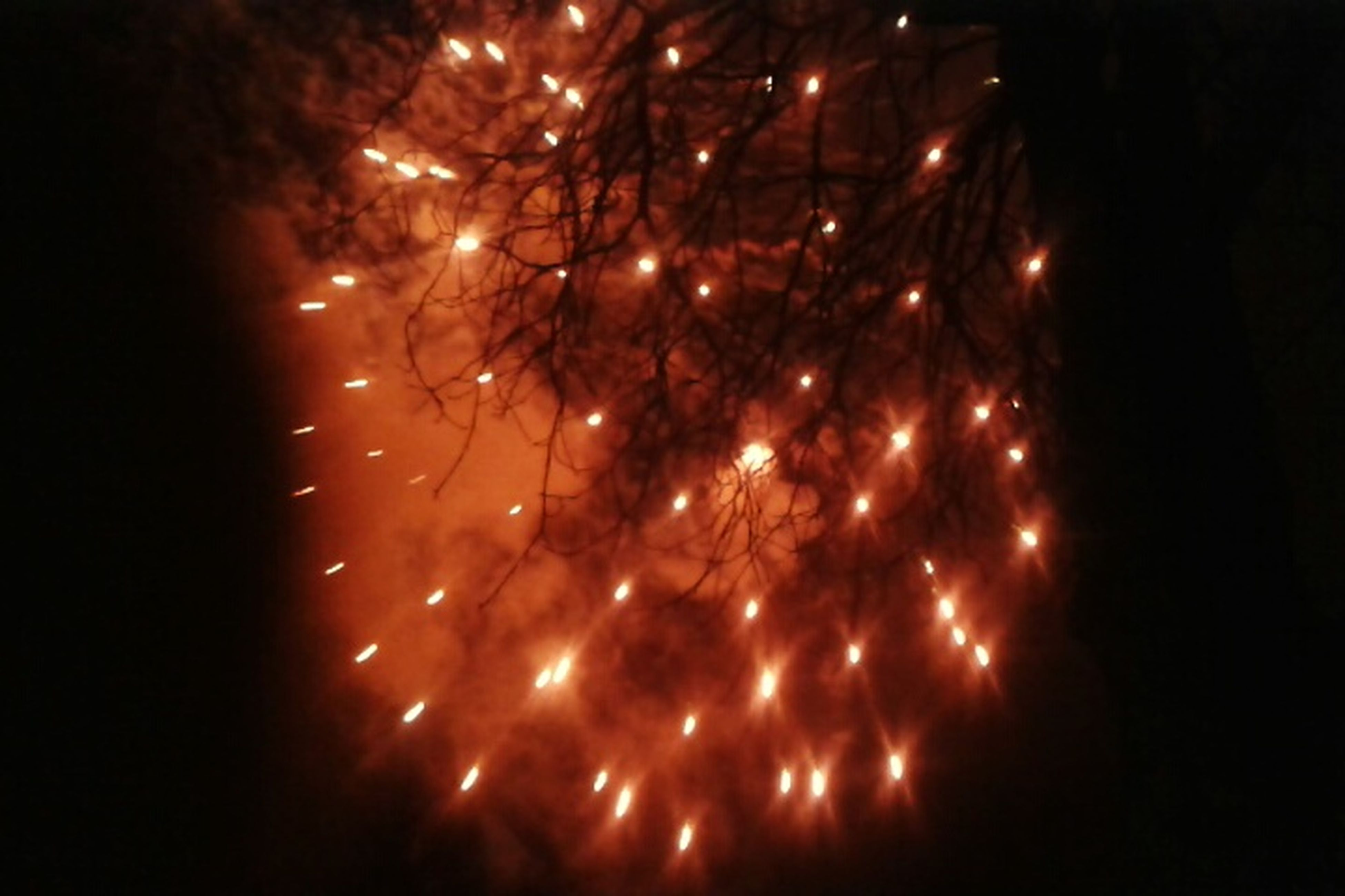 night, illuminated, long exposure, firework display, motion, glowing, sparks, exploding, low angle view, celebration, firework - man made object, sky, firework, blurred motion, arts culture and entertainment, dark, event, outdoors, no people, light