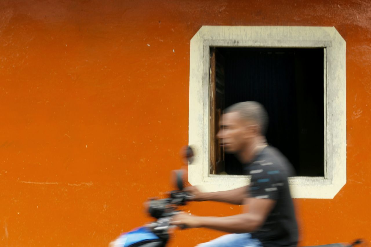 Orange Scooter Window Driving Speed Transportation One Person On The Move Travel Adult Outdoors People Day People Watching Traveling Street Photography Colombia The City Light Let's Go. Together.