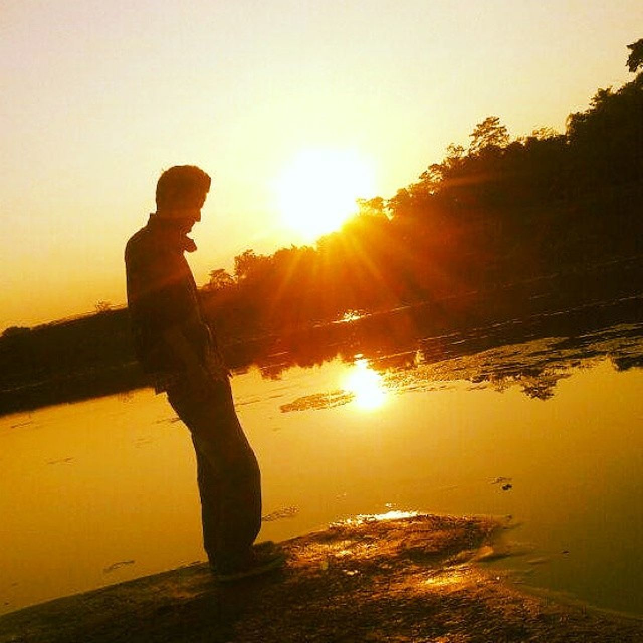 sunset, lens flare, sunlight, silhouette, one person, back lit, sunbeam, sun, one man only, nature, standing, only men, adult, adults only, people, morning, reflection, outdoors, men, lake, tree, side view, water, full length, sky, forest, sport, vacations, young adult, scenics, beauty in nature, day
