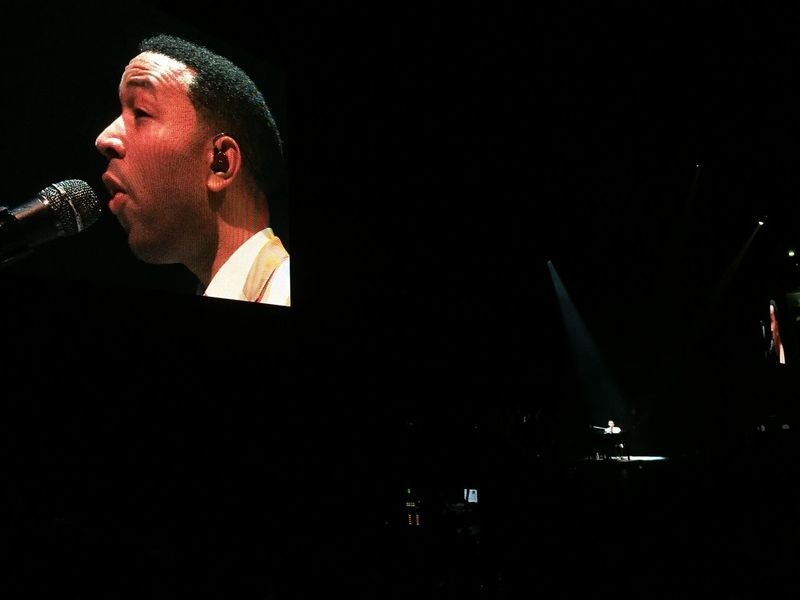 2014. John Legend In Concert. Black Background Concert Photography Creativity Dark Dark Room Darkroom Electric Light Galaxy John Legend Low Angle View Night Young Adult