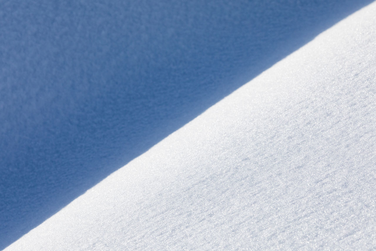 Full frame shot of snow with diagonal shadow Backgrounds Beauty In Nature Blue Close-up Cold Temperature Copy Space Creativity Dividing Line Frozen Full Frame Geometric Shape Ideas Natural Pattern Nature No People Outdoors Shadow Simplicity Slanted Smooth Snow Textured  Textured  Tilt Triangle Shape
