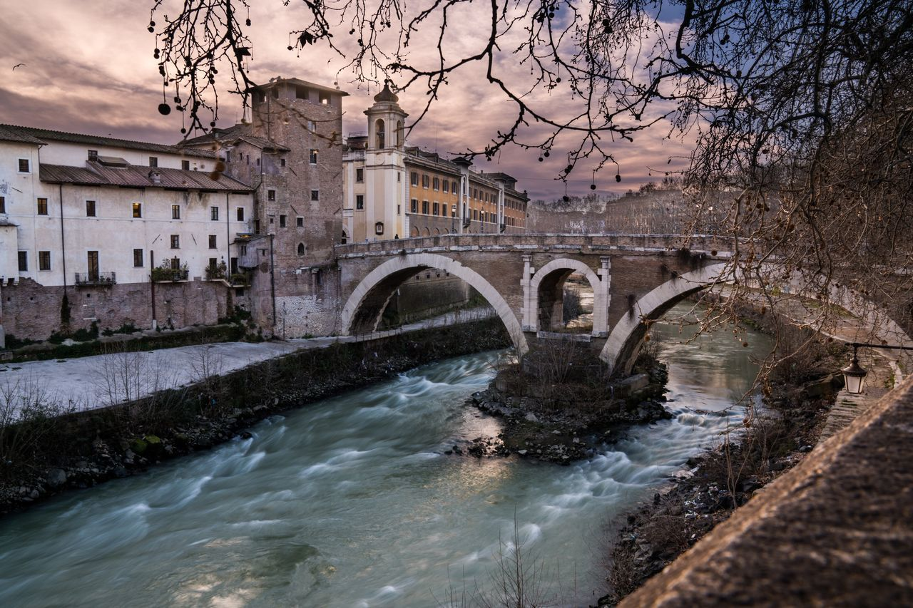 Île de Rome. Water Tree Built Structure Bridge - Man Made Structure Architecture Travel Destinations Outdoors Building Exterior Long Exposure Waterfront Connection City Arch Sky Scenics Dusk Europe Rome Italy Roma Rome Italy Bella Italia Italia Italy❤️ Slow Shutter