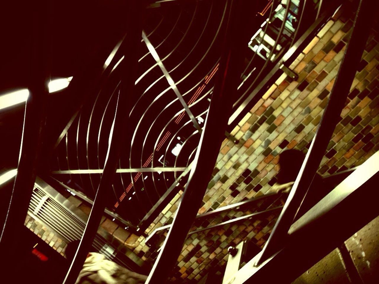 no people, built structure, indoors, architecture, illuminated, amusement park ride, low angle view, close-up, spiral staircase, day