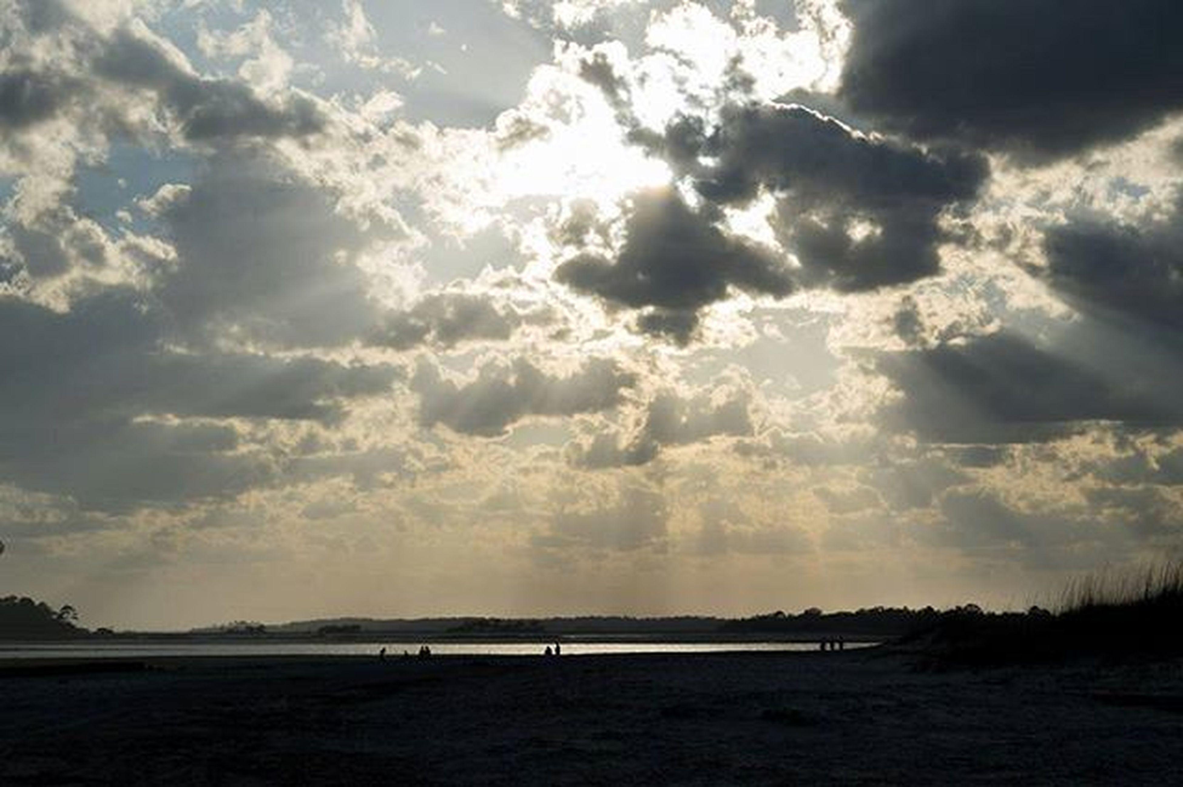 sky, tranquil scene, tranquility, scenics, beauty in nature, cloud - sky, sea, water, nature, sunset, beach, silhouette, cloudy, idyllic, cloud, horizon over water, sunlight, sun, shore, landscape