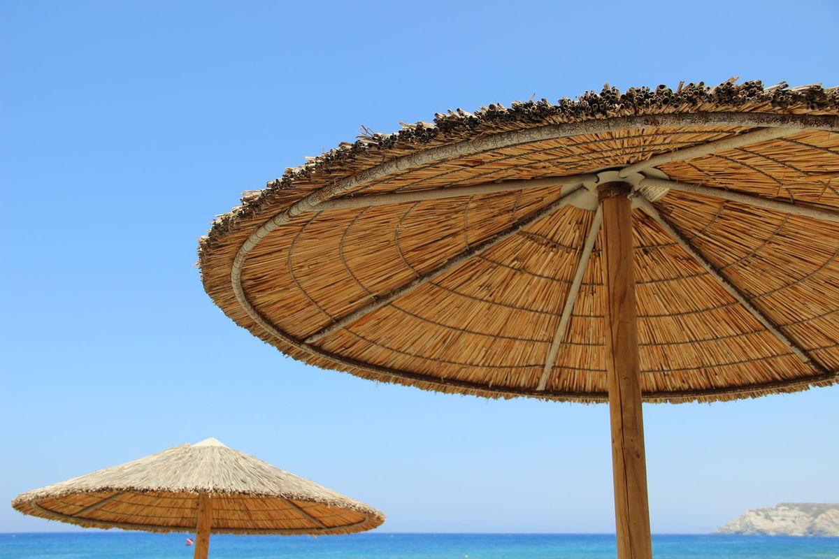 Crete Greece Crete Island Beach Beach Umbrella Beauty In Nature Blue Clear Sky Crete Crete Heraklion Creteisland Day Heraklion Nature No People Outdoors Sea Shelter Sky Summer Thatched Roof Water
