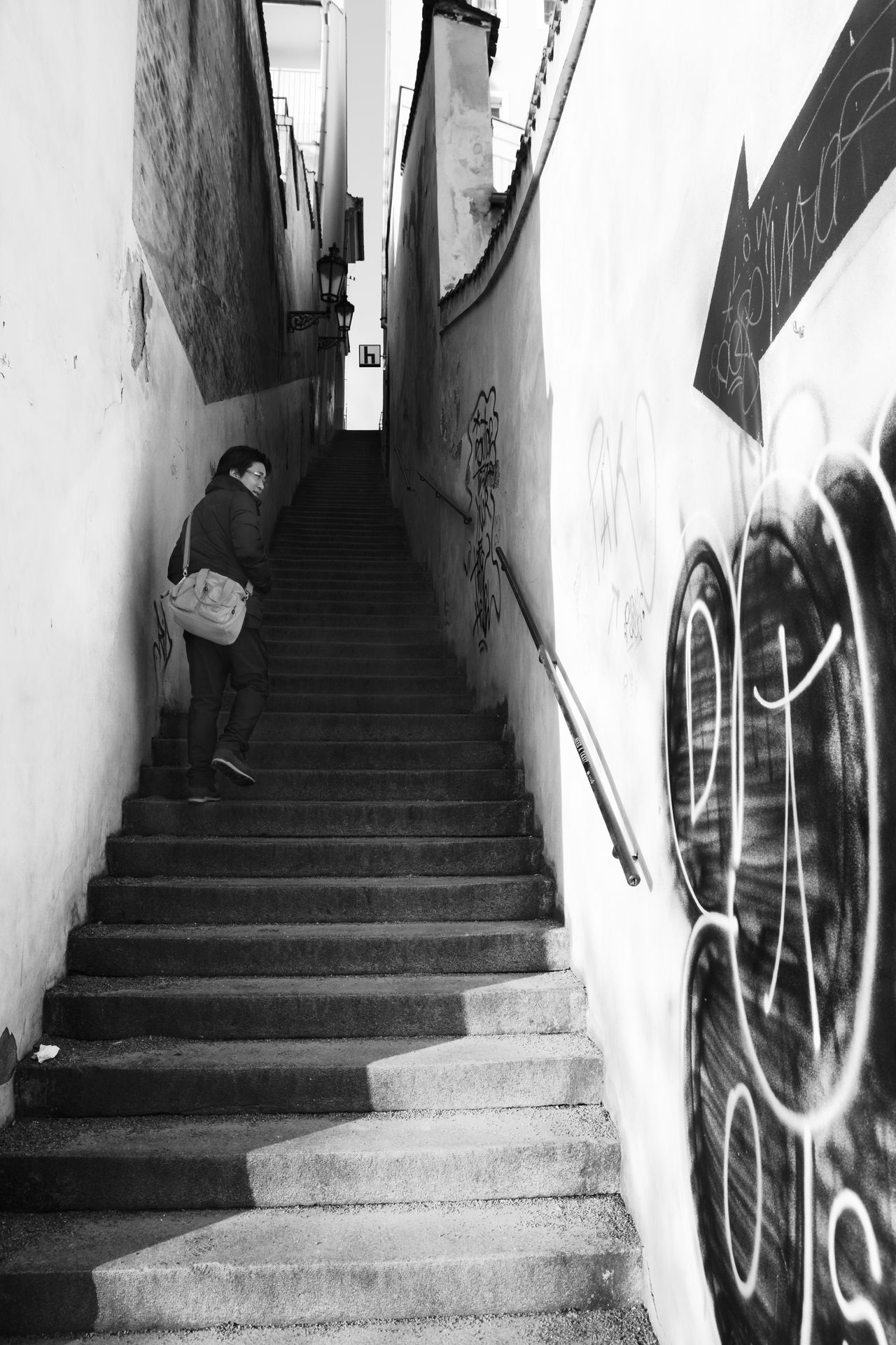 Follow the black arrow Adult Asian Man Black And White Blackandwhite Photography Bw City Life Go Up Light And Shadow Man Person Stair Stairway Street Street Photography Streetphotography Tour Tourism The City Light