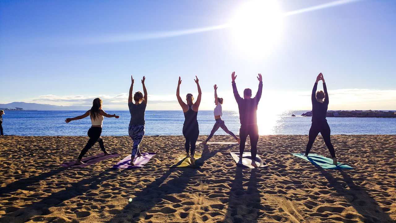 Arms Raised Beach Sea Water Sky Togetherness Standing Sunlight Sun Horizon Over Water Community Young Adult Friendship Outdoors Nature Tranquility Travel Destinations Yoga Yoga Pose Yoga Practice Yogainspiration Beach Photography Beach Life Barceloneta Beach Barcelona