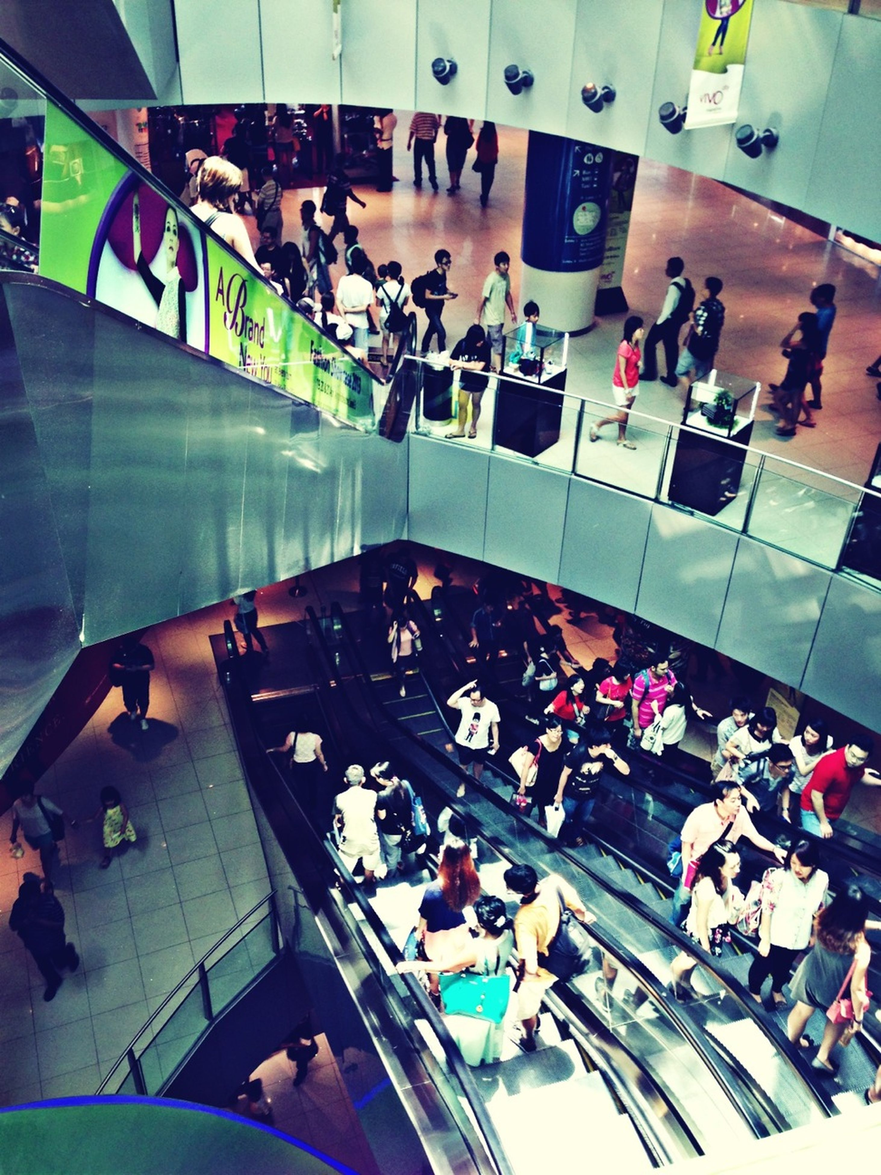 high angle view, indoors, large group of people, in a row, men, large group of objects, transportation, abundance, modern, person, arrangement, order, variation, built structure, day, architecture, travel, ceiling, lifestyles