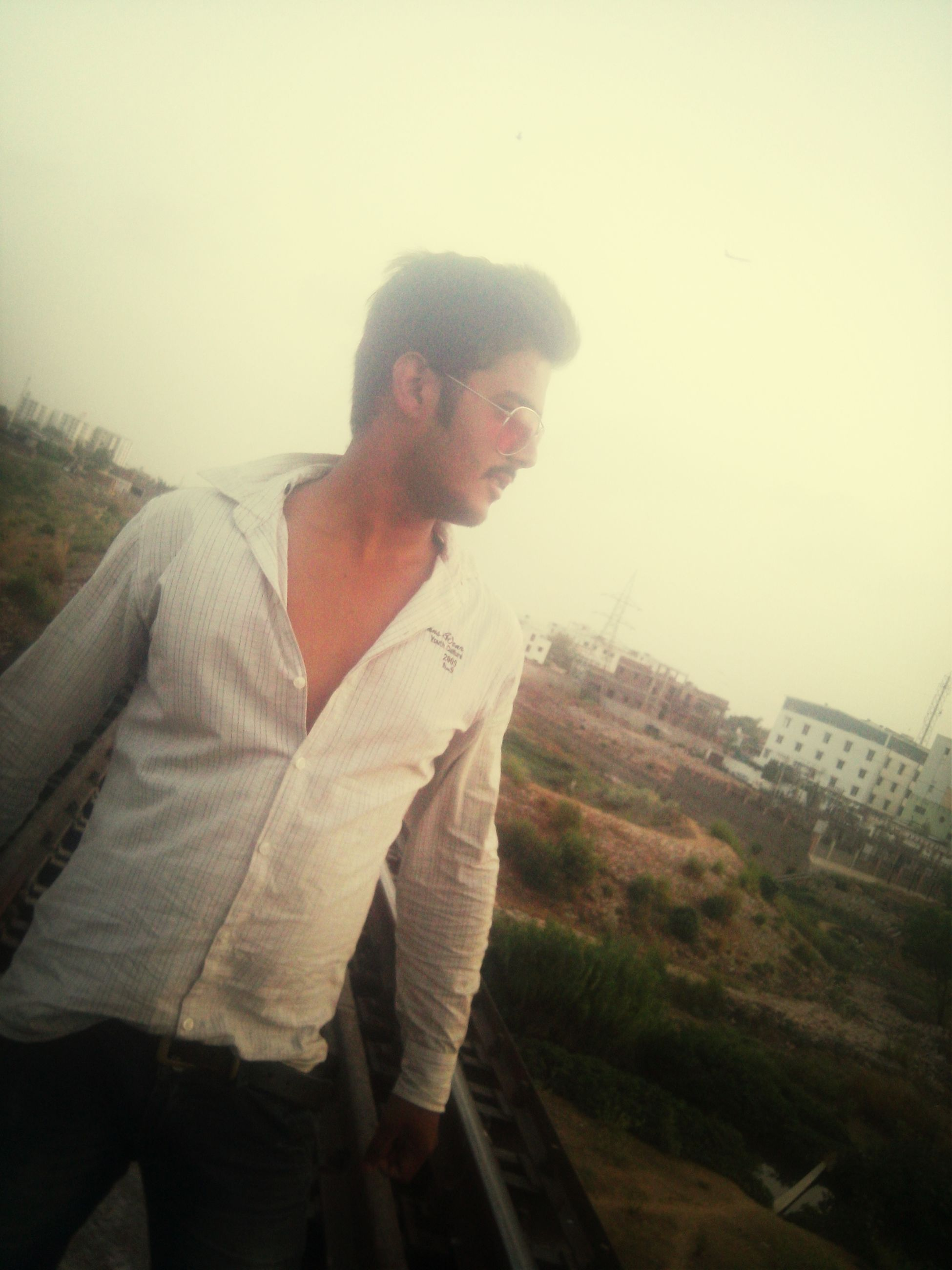 lifestyles, young adult, casual clothing, leisure activity, person, young men, three quarter length, standing, waist up, side view, warm clothing, looking away, fog, contemplation, front view, full length, mid adult