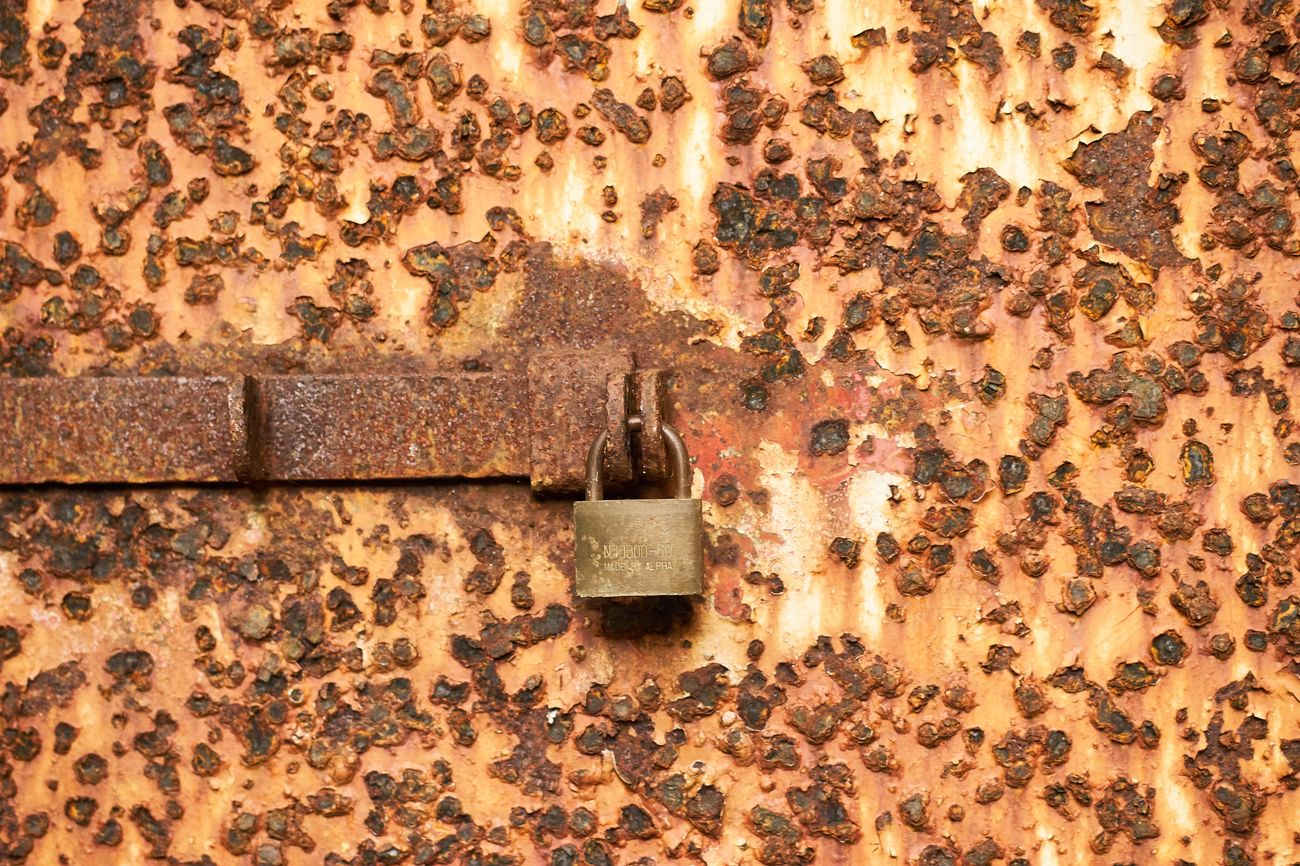 Damaged Backgrounds Rusty Close-up No People Outdoors Textured  Day Wall Design EyeEm EyeEm Best Shots Locked Lock Padlock Rust Old Architecture_collection Time EyeEm Gallery Architecture (null)Full Length Door Designing