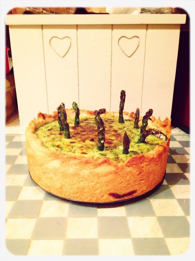 Midnight quiche making session complete. forgot to put asparagus in, so stuck it in (literally) half way through cooking. :)