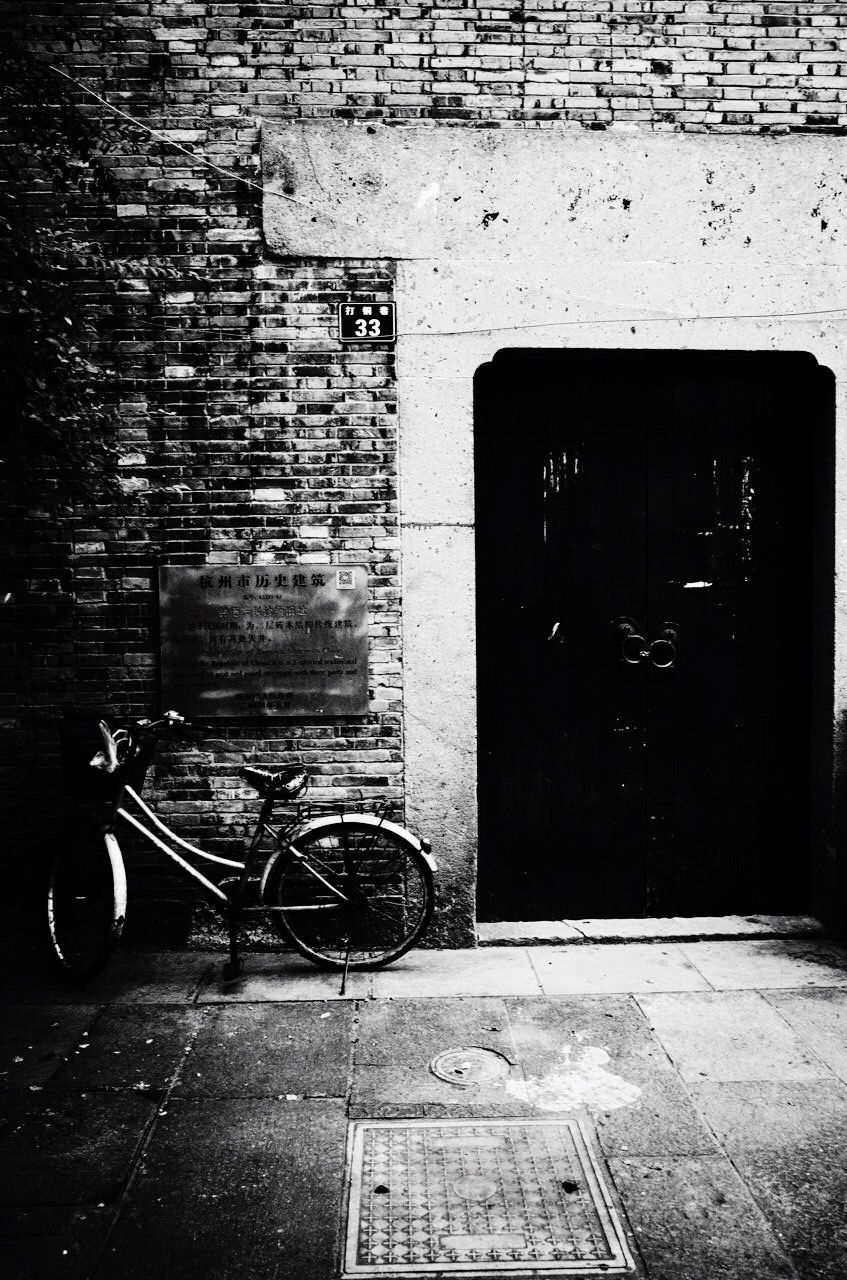 architecture, built structure, door, building exterior, brick wall, no people, outdoors, day, bicycle