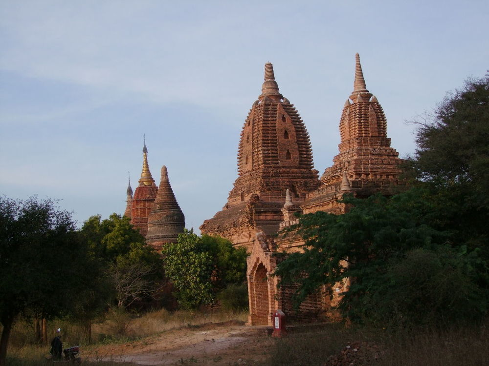 Temples in Bagan Archaeological Site (13th & 14th century) Amazing View Ancient Architecture Blue Sky White Clouds Buddhist Buddhist Architecture Buddhist Culture Buddhist Temples Building Exterior Composition Evening Light History No People Outdoor Photography Pagodas Place Of Worship Religion Spirituality Sunlight And Shadow Sunset Light Temple Tourism Tourist Attraction  Travel Destinations Trees
