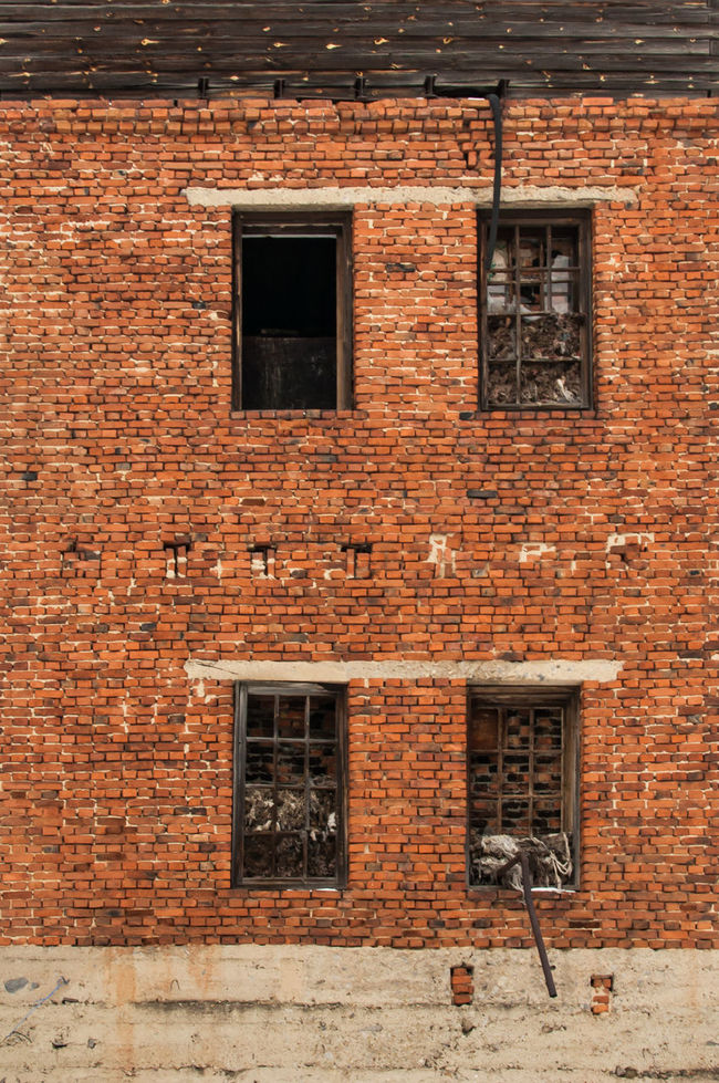 Abandoned Buildings Architecture Bad Condition Brick Building Brick Wall Broken Glass Broken Windows Building Exterior Built Structure Darkness In Window No People Outdoors Strange Water Pipes Window
