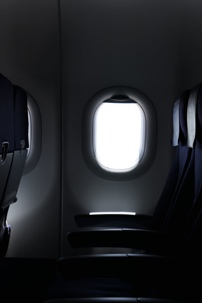 Empty Seats By Window In Airplane