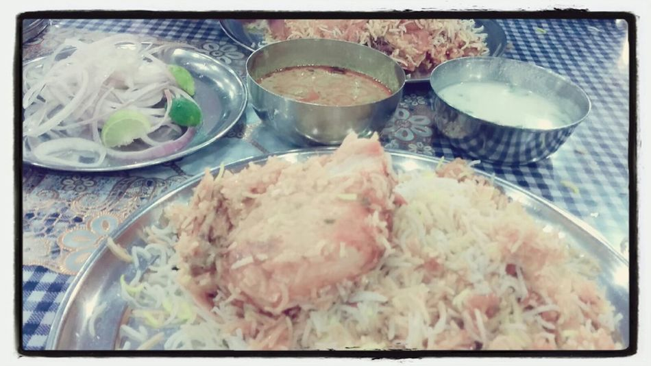 Enjoying A Meal Hyderabad Chickenbiriyani