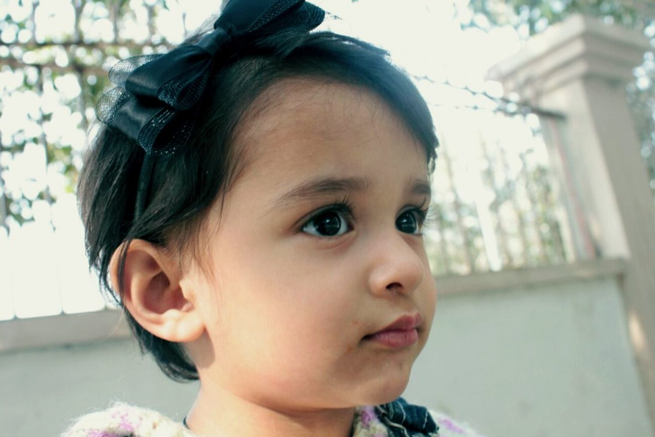 childhood, real people, innocence, cute, focus on foreground, close-up, day, baby, headshot, one person, outdoors, portrait