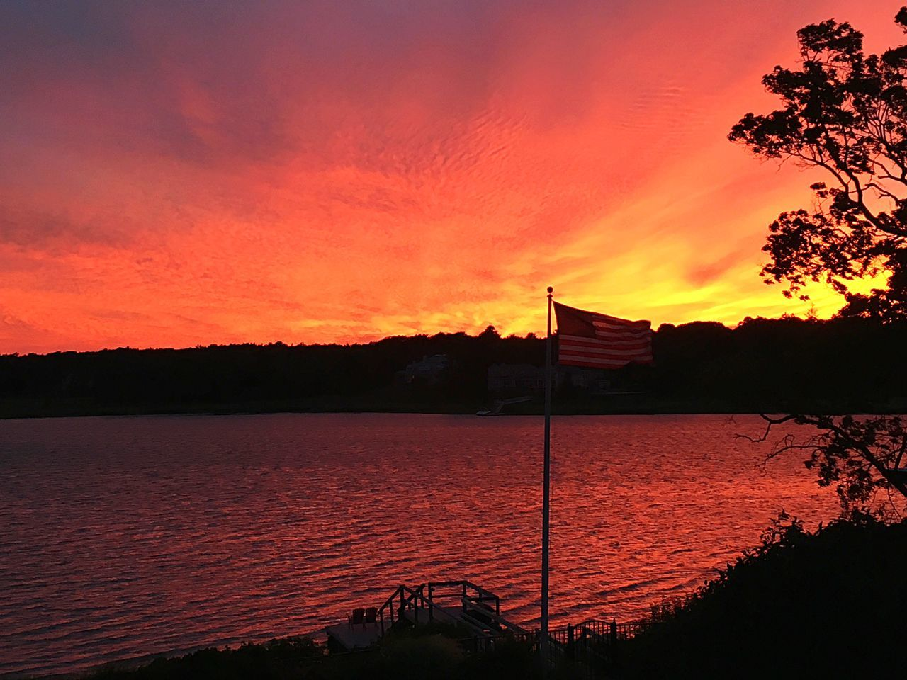 Sunset Water Orange Color Tranquility Sky Beauty In Nature Rippled Dramatic Sky Flag Pole Flag America Nature Waterfront Tranquil Scene