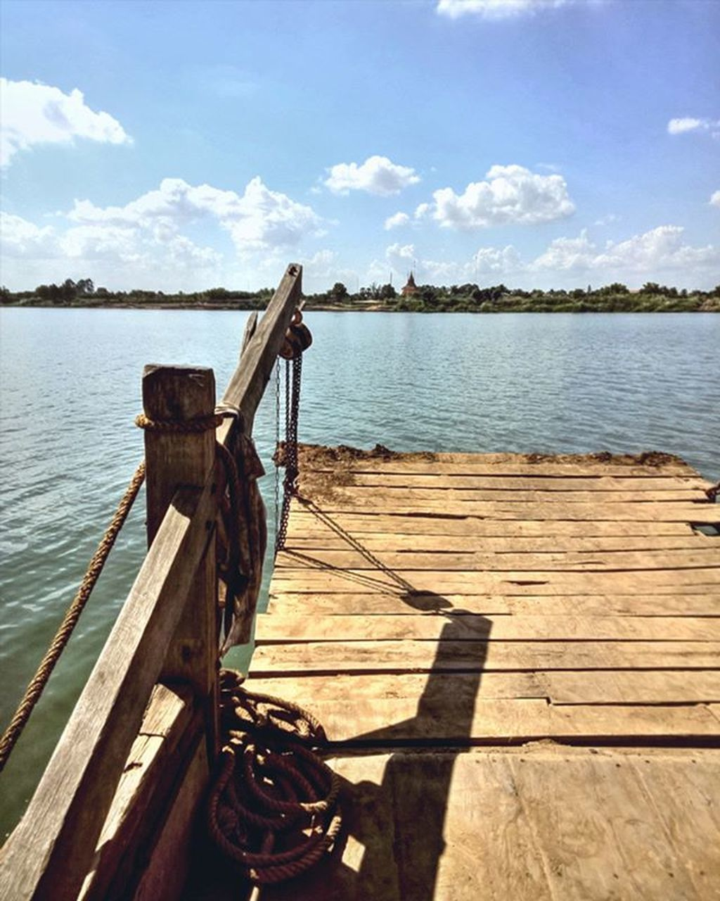 water, wood - material, no people, day, outdoors, sky, tranquility, nautical vessel, lake, nature, cloud - sky, sunlight, scenics, beauty in nature, close-up