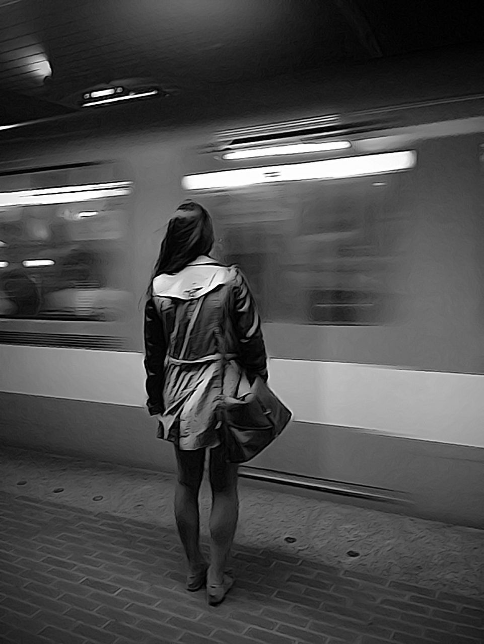 real people, rear view, blurred motion, transportation, full length, one person, public transportation, mode of transport, train - vehicle, motion, lifestyles, indoors, illuminated, standing, women, men, night, people